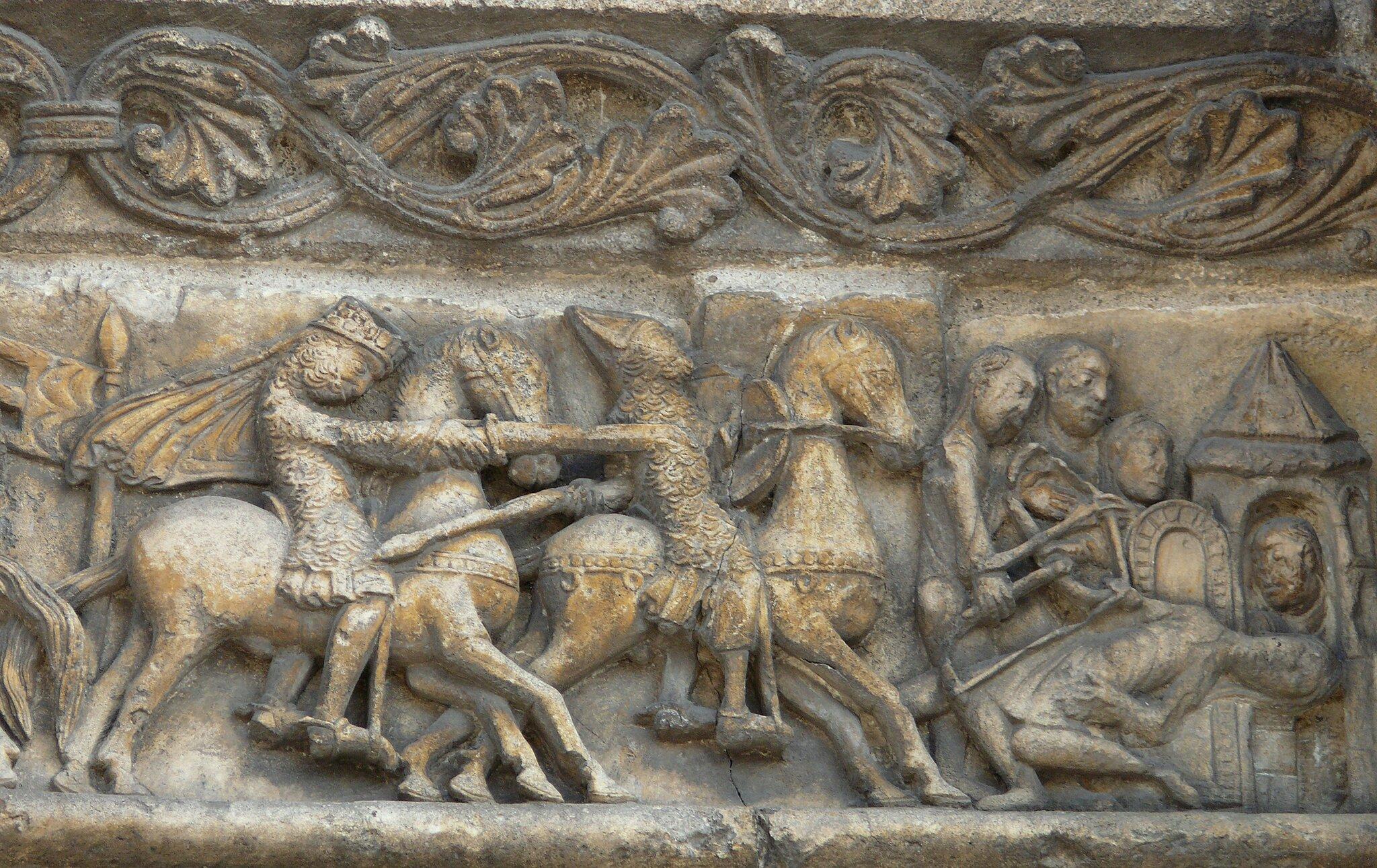 Fragment płaskorzeźby ilustrującej Pieśń oRolandzie Fragment płaskorzeźby ilustrującej Pieśń oRolandzie Źródło: Katedra Saint-Pierre, Angoulême, domena publiczna.
