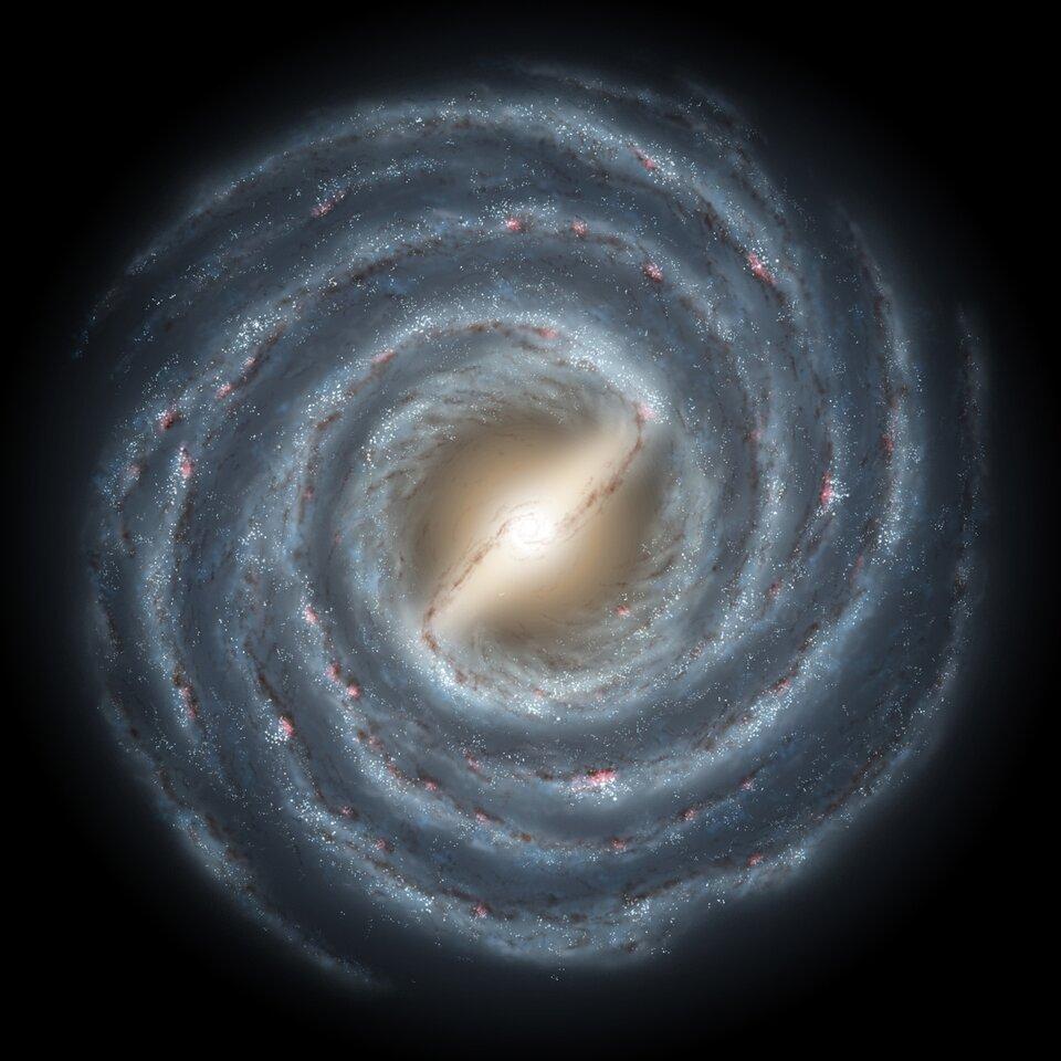 Zdjęcie przedstawia galaktykę spiralną zpoprzeczką.