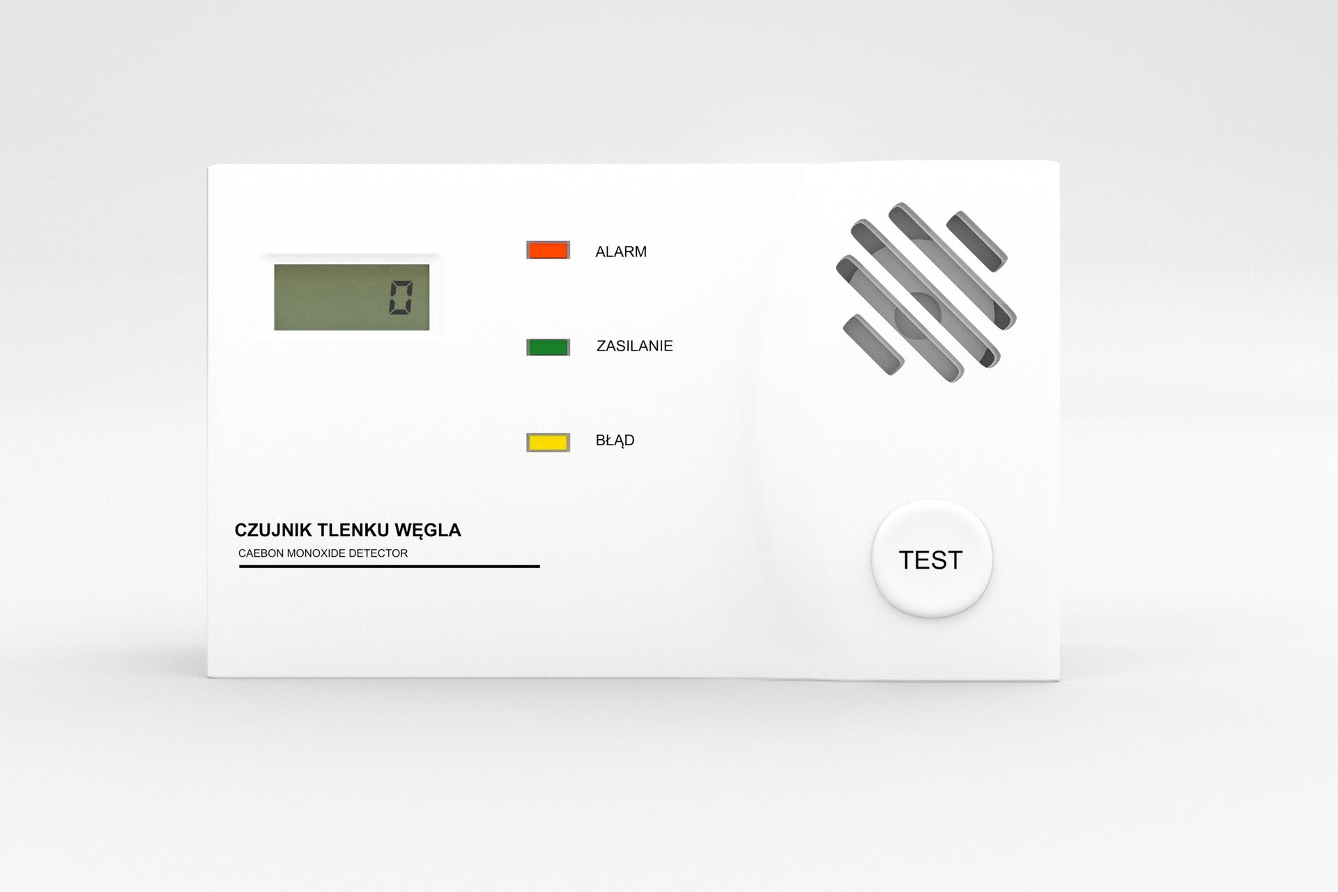 Fotografia przedstawiajaca czujnik dwutlenku węgla zdiodą alarm, zasilanie test ipokazanym na wyświetlaczu wskaźnikiem.