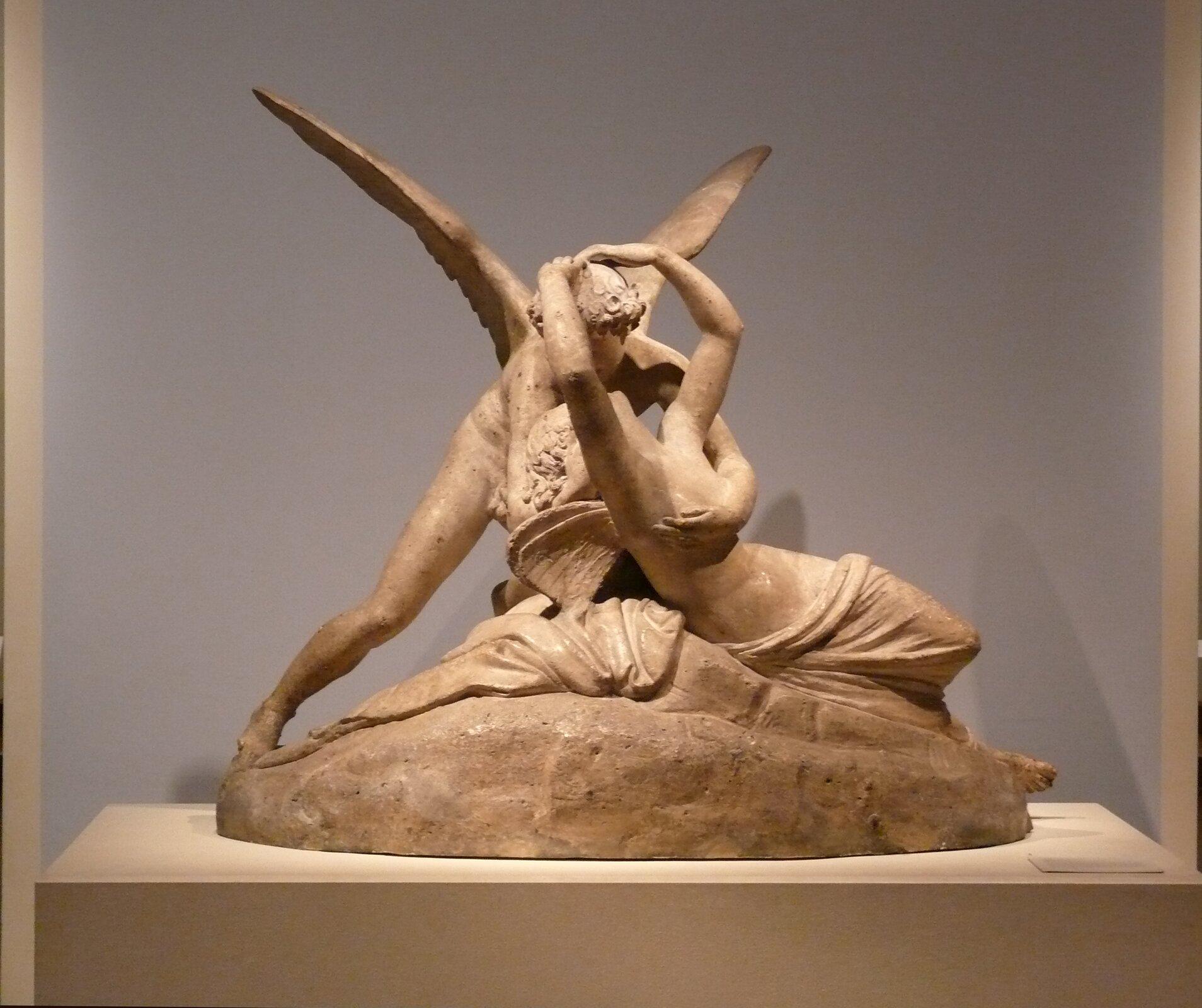 Psyche budzona przez pocałunek Kupidyna Źródło: Antonio Canova, Psyche budzona przez pocałunek Kupidyna, 1793, rzeźba wmarmurze, Muzeum wLuwrze, domena publiczna.