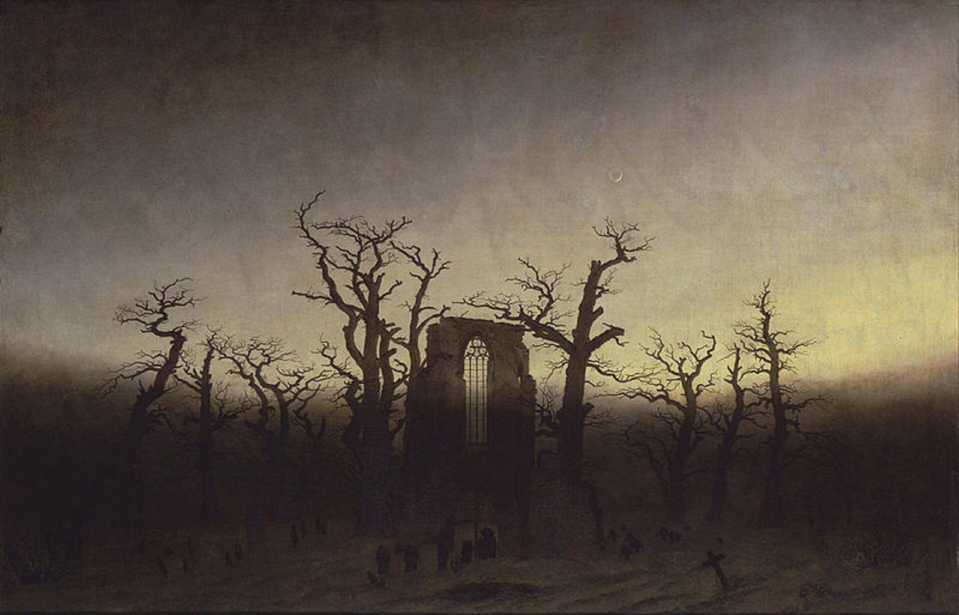 """Ilustracja okształcie poziomego prostokąta przedstawia obraz Caspara Davida Friedricha """"Opactwo wdębowym lesie"""". Ukazuje pejzaż zsuchymi dębami, pośród których stoi gotycka brama. Znajduje się ona wcentrum obrazu. zamknięta jest łukiem ostrym.  Dolna część dzieła jest ciemna, dominują wniej brązy. Górna to niebo ożółto-fioletowo-brązowych barwach."""