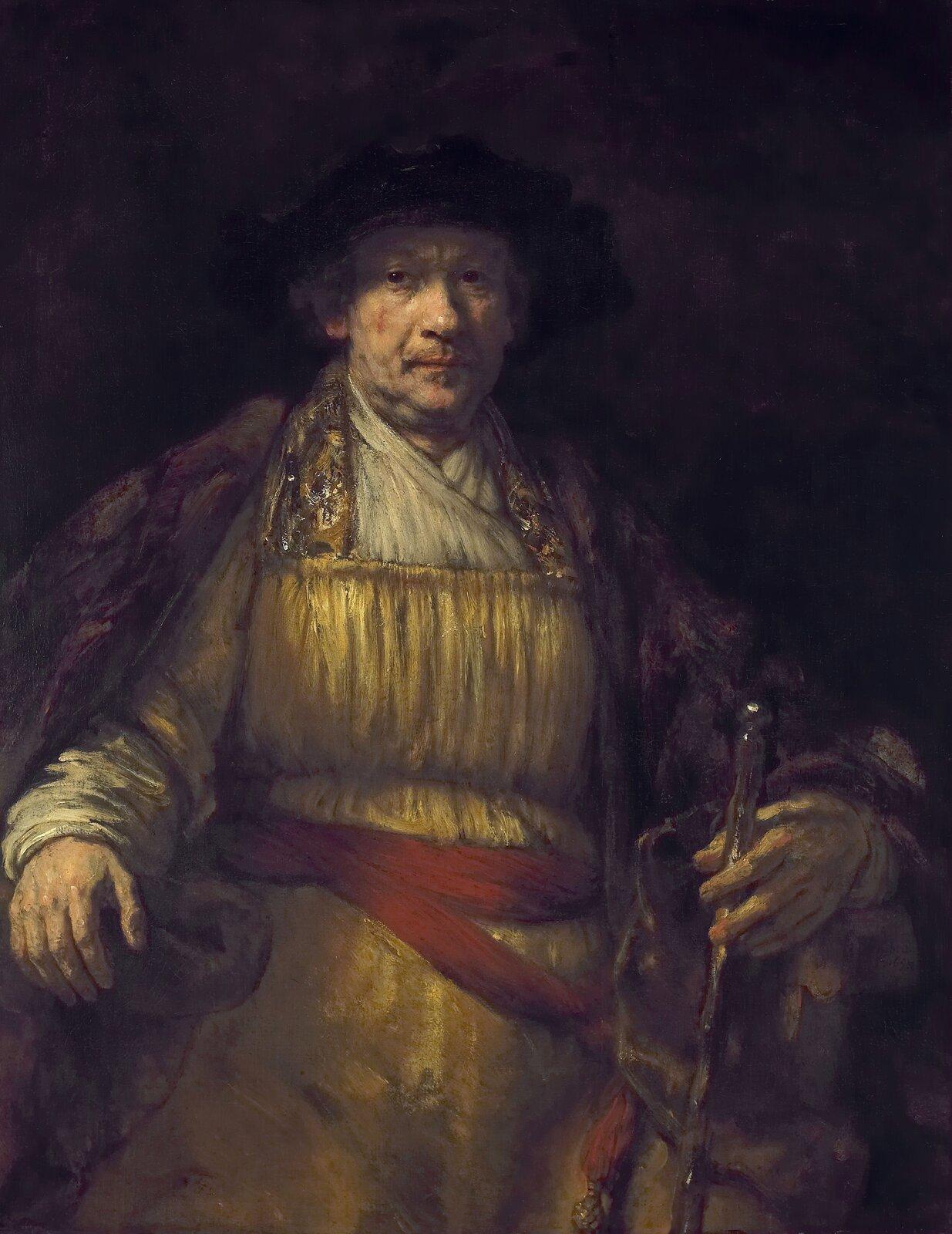 """Ilustracja przedstawia """"Autoportret"""" Rembrandta van Rijna. Na ciemnym tle znajduje się siedzący malarz wstarszym wieku, wczarnym kapeluszu na głowie. Ma na sobie złotą szatę, przepasaną wpasie czerwoną szarfą izarzuconą na ramiona ciemną pelerynę. Prawą rękę ma opartą na poręczy fotela. Wlewej dłoni trzyma laskę. Wzrok ma skierowany przed siebie, wstronę widza."""