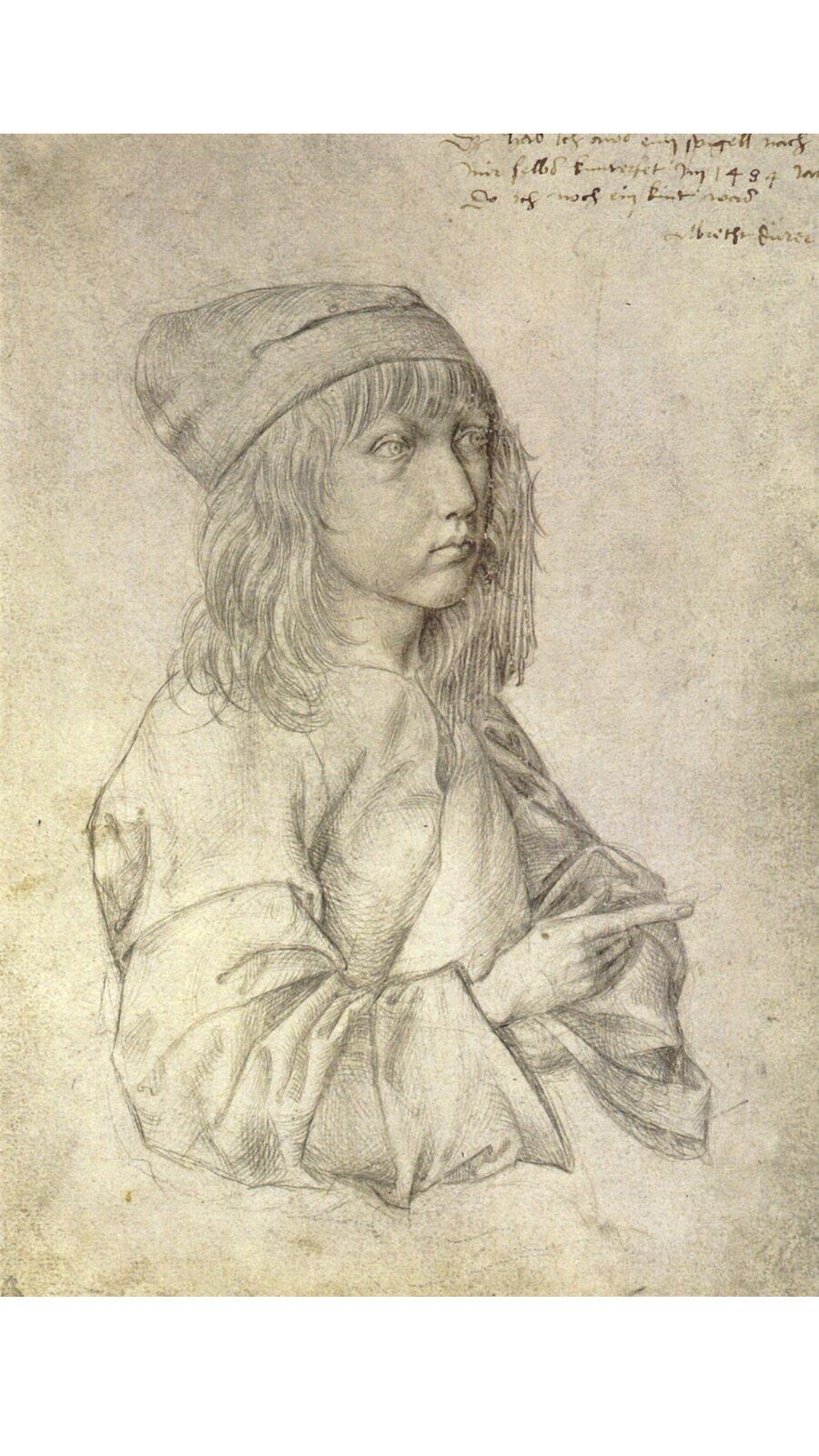Rysunek przedstawia popiersie chłopca. Ma włosy do ramion. Prawą ręką wskazuje przed siebie.