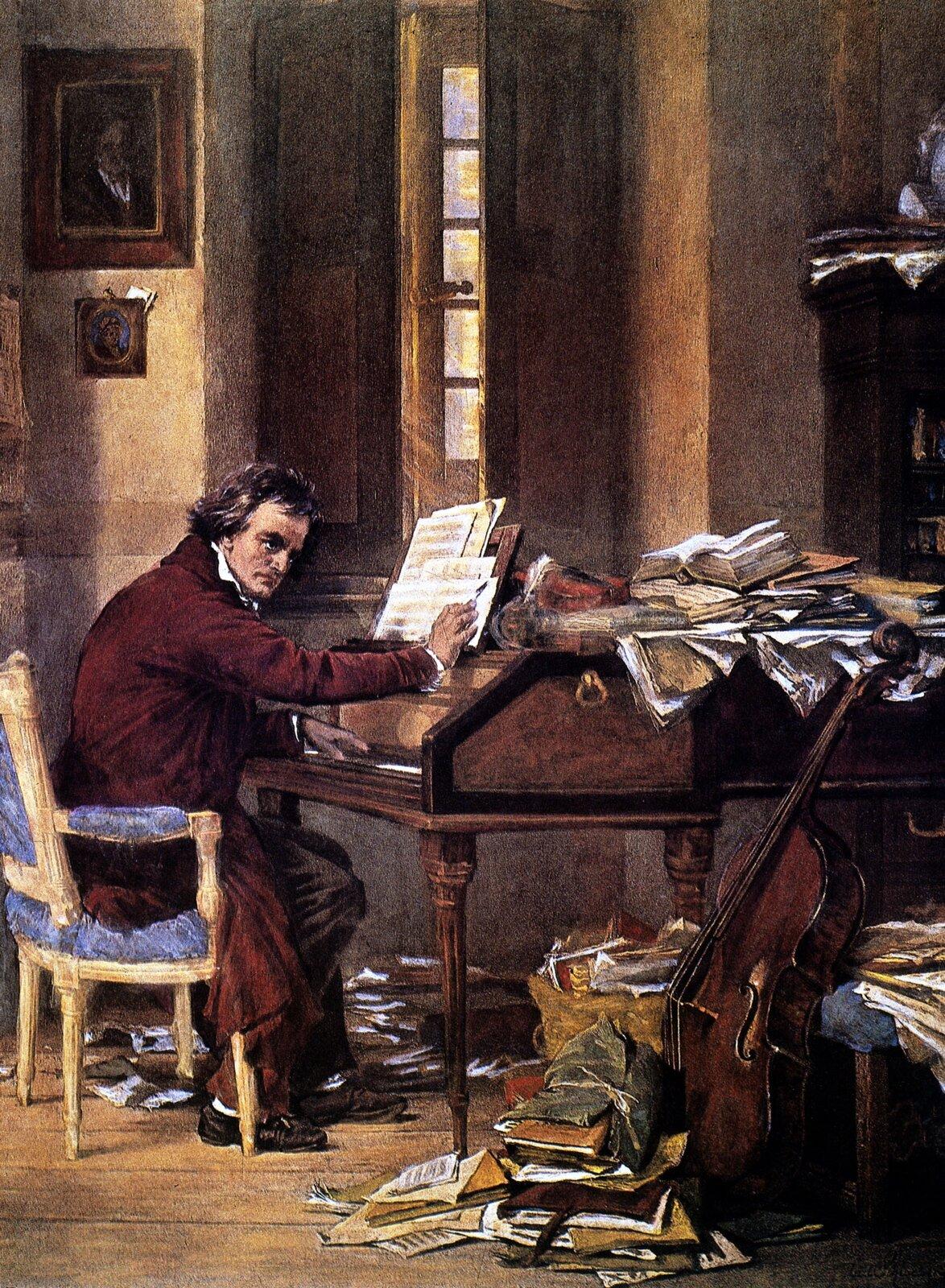 """Ilustracja przedstawia obraz Carla Schloessera """"Ludwig van Beethoven przy pracy"""". Na obrazie kompozytor siedzi przy fortepianie. Jedną rękę trzyma na klawiszach, natomiast wdrugiej trzyma ołówek inotuje na kartkach. Mężczyzna ma skupiony wyraz twarzy siedzi wbordowych szatach. Wokół fortepianu leży dużo krzywo porozkładanych książek."""