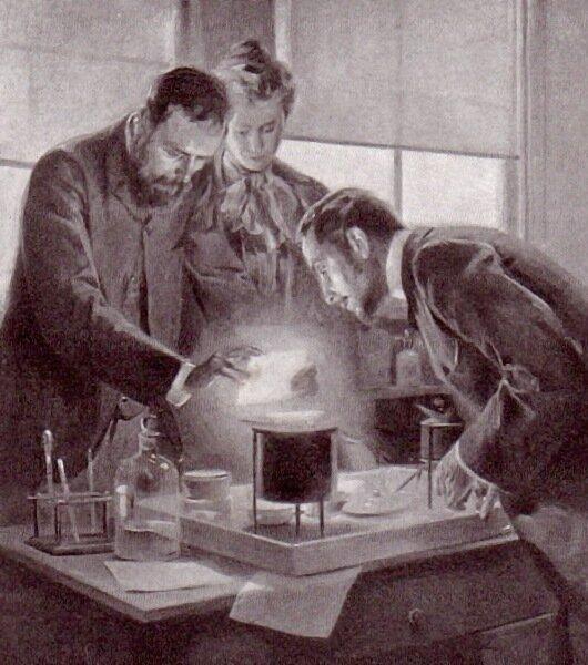 Pan iPani Curie eksperymentują zradem Źródło: André Castaigne, Pan iPani Curie eksperymentują zradem, 1903, domena publiczna.