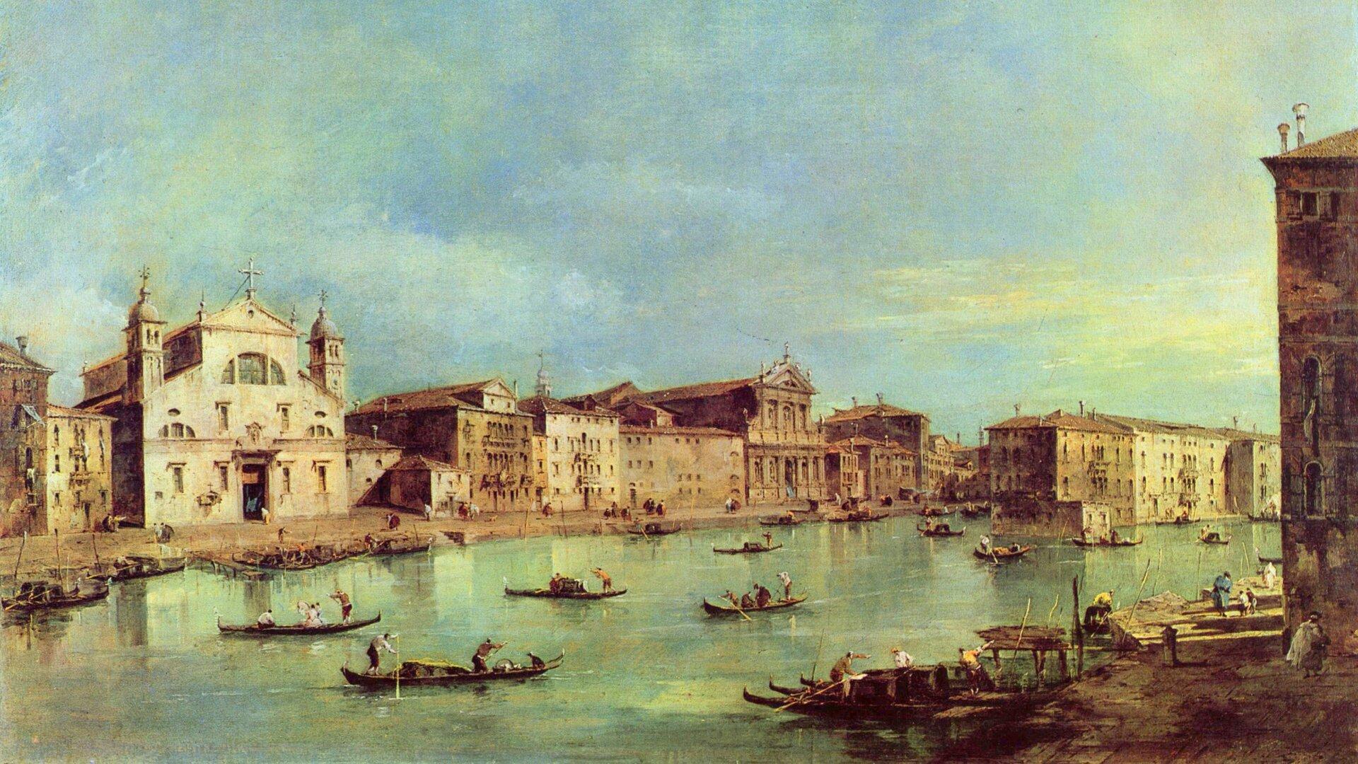 """Obraz przedstawia zabudowę miejską nad kanałem, po którym pływają łódki. Jest podpisany: """"Francesco Guardi »Canale Grande«""""."""