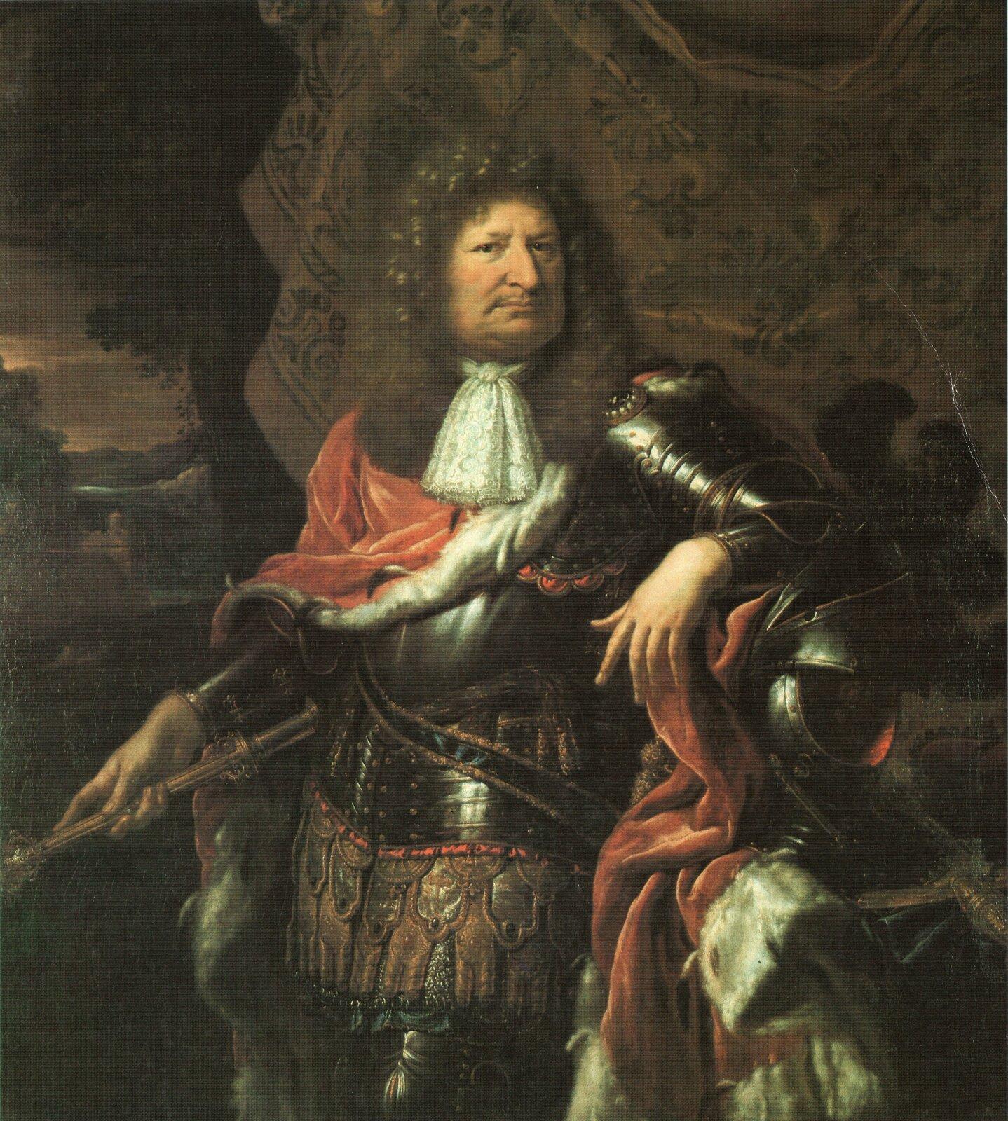 Obraz przedstawia mężczyznę wśrednim wieku, ubranego wparadną zbroję zbuławą dowódczą wprawej dłoni.