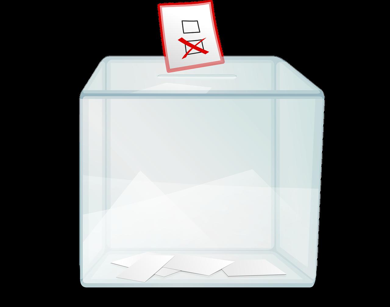 grafika przedstawia przezroczysta urne wyborczą do którejwpada karta wyborcza