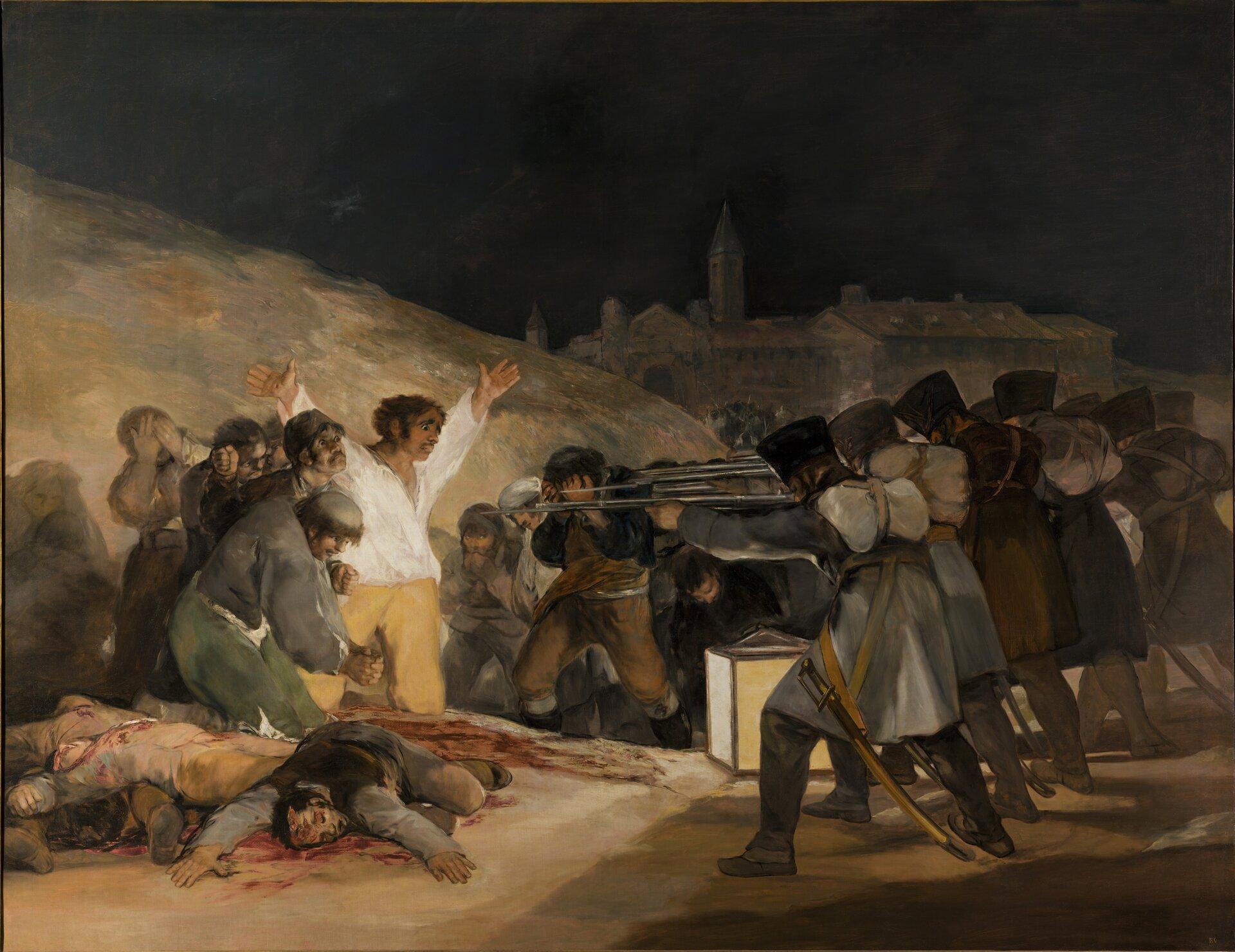 """Ilustracja przedstawia obraz Francisco Goya pt. """"Trzeci maja 1808"""" (albo """"Rozstrzelanie powstańców madryckich""""). Obraz powstał w1814 roku. Zprawej strony obrazu znajduje się pluton egzekucyjny przygotowany do śmiertelnej salwy. Zlewej strony widzimy grupę osób, które zostaną rozstrzelane. Wśród nich znajduje się mężczyzna wbiałej koszuli zrękoma rozłożonymi na boki. Światło obrazu rozświetla właśnie tę postać. Na obrazie widoczna jest także grupa mężczyzn zakrywająca twarz rękoma. Za postaciami znajduje się panorama miasta."""