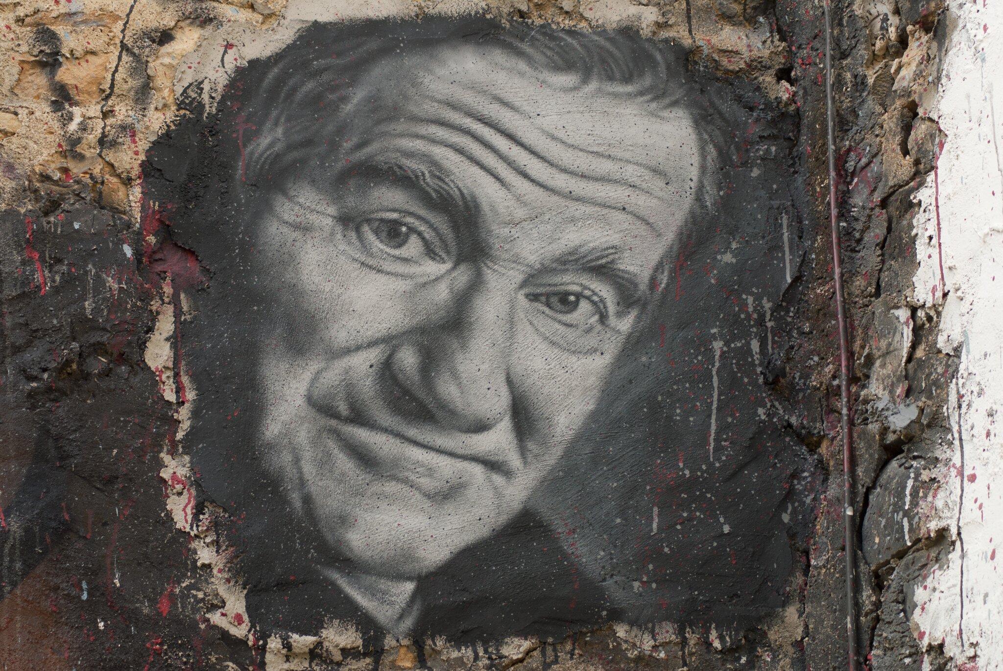 Robin Williams Robin Williams,odtwórca roli Johna Keatinga wfilmieStowarzyszenie umarłych poetów (1989, reż. Peter Weir) Źródło: Thierry Ehrmann, Robin Williams, rysunek, licencja: CC BY 2.0.