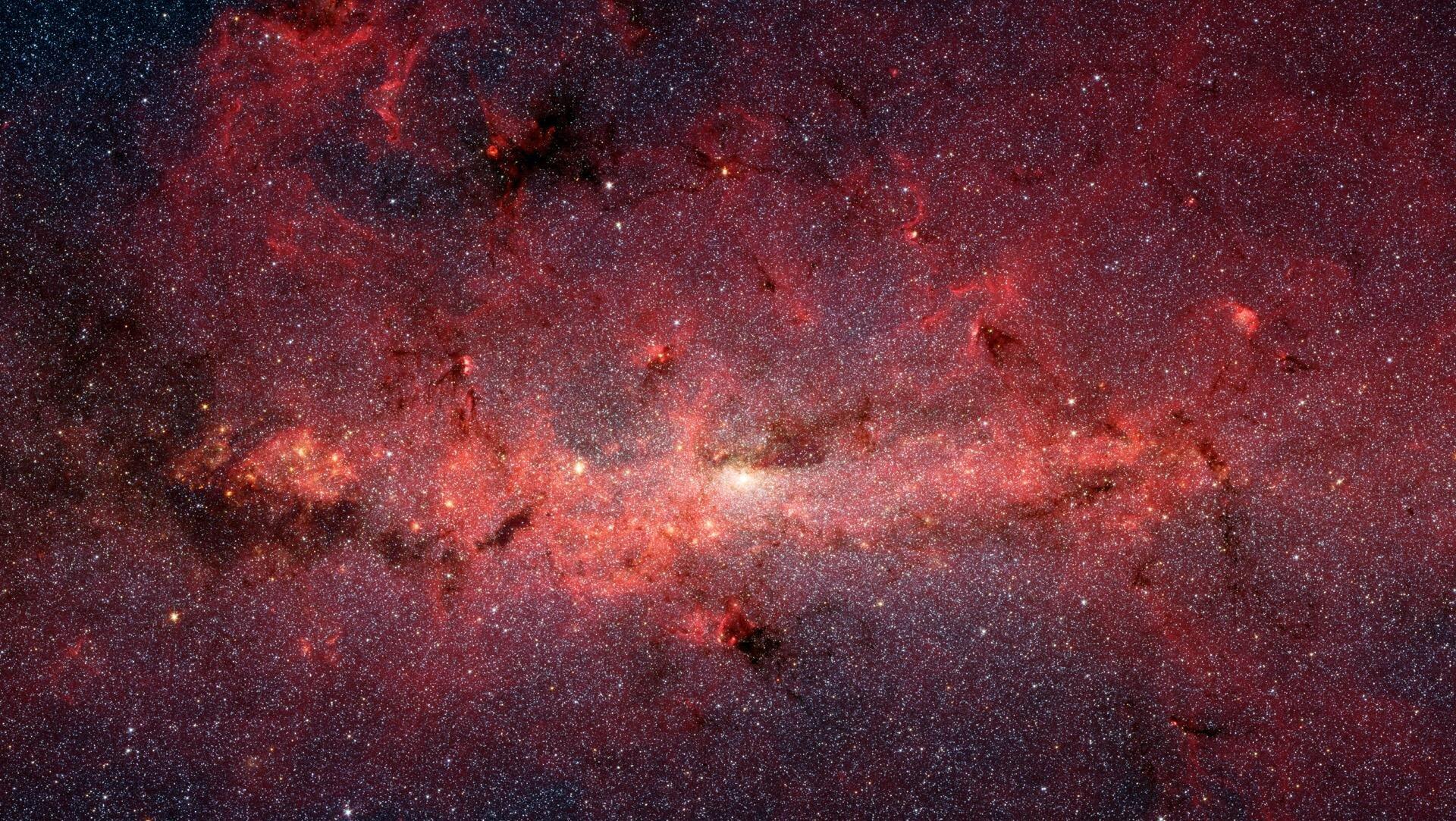 Zdjęcie przedstawia centralne obszary Galaktyki sfotografowane wpodczerwieni.