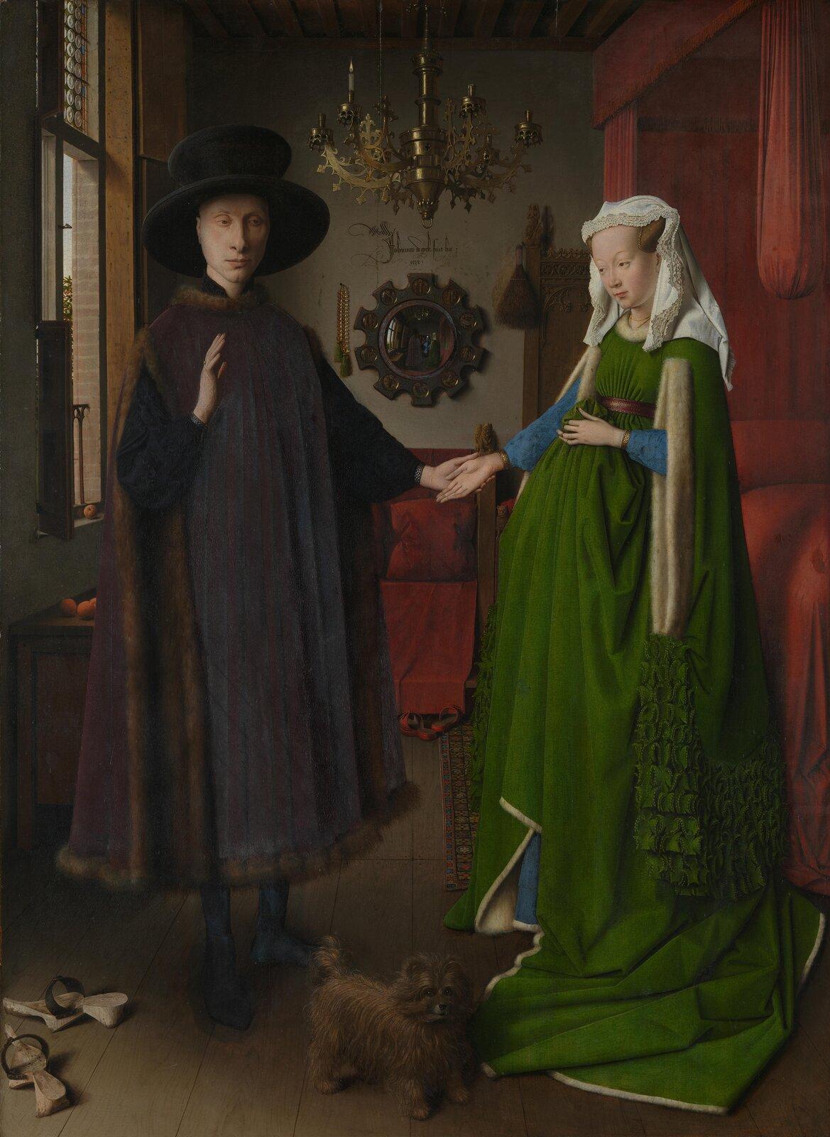 Portret małżonków Arnolfinich Źródło: Jan van Eyck, Portret małżonków Arnolfinich, 1434, olej na desce, National Gallery, Londyn, domena publiczna.