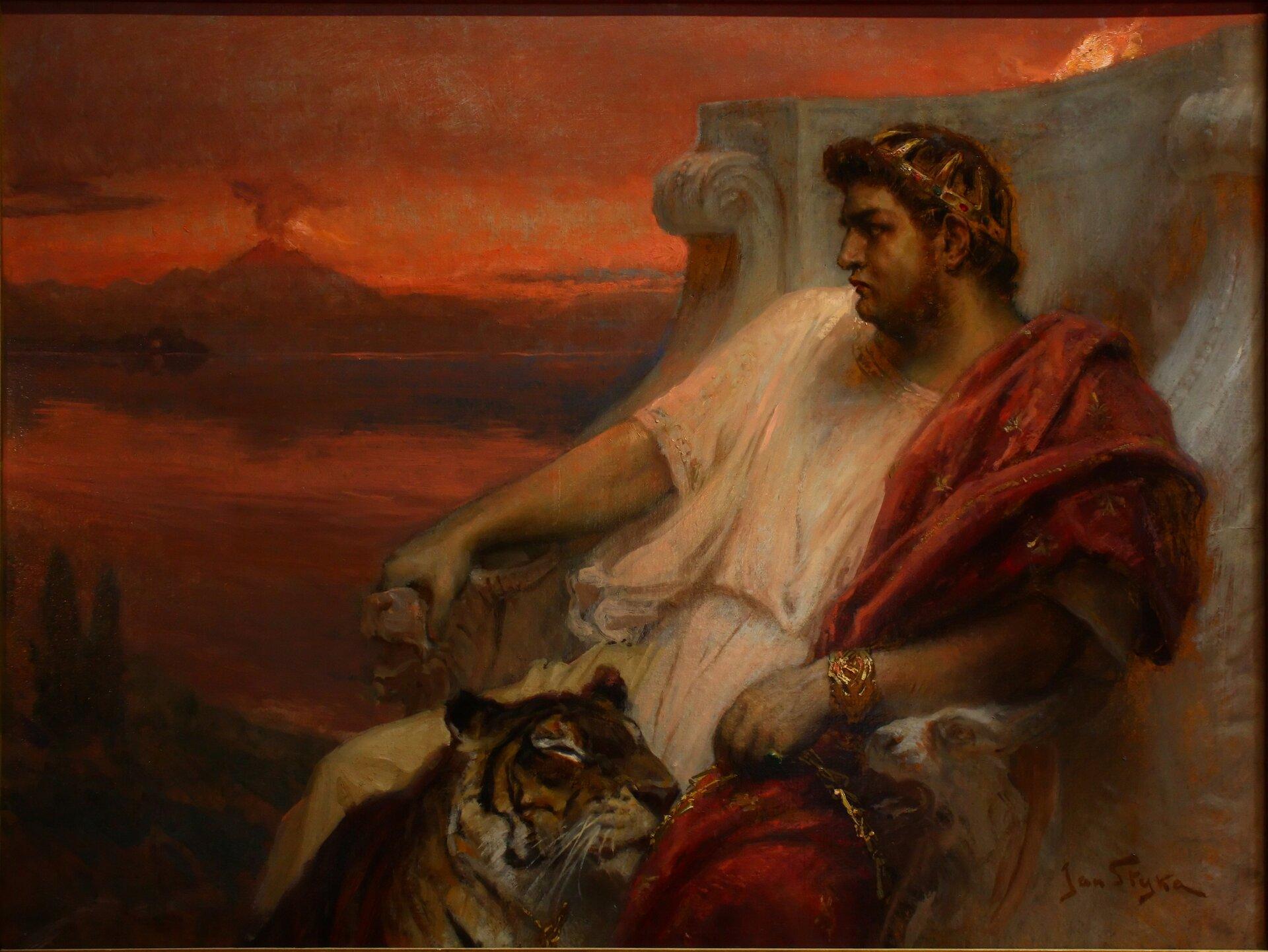 """Kolorowa ilustracja przedstawia dzieło Jana Styki """"Neron wBajach"""". Po prawej stronie obrazu, na kamiennym tronie, siedzi Neron. Ręce cesarza oparte są orzeźbione podłokietniki (głowy zwierząt). Młody mężczyzna ociemnych, krótkich włosach, ujęty zprofilu, patrzy wdal. Ubrany jest wbiałą tunikę ipurpurową togę. Wręku trzyma łańcuch, do którego przypięty jest tygrys. Głowa zwierzęcia spoczywa na kolanach cesarza. Wdali majaczy dymiący wulkan Wezuwiusz."""