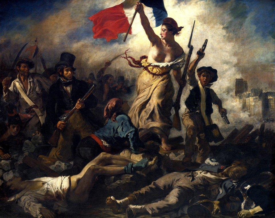 """Wolność wiodąca lud na barykady """"Wolność wiodąca ludna barykady"""" obraz E. Delacroix'a z1830 r. Postać ztego obrazu byłą prawdopodobnie inspiracją dla Statuy Wolności. Źródło: Eugène Delacroix, Wolność wiodąca lud na barykady, 1830, Olej na płótnie, Muzeum wLuwrze, domena publiczna."""