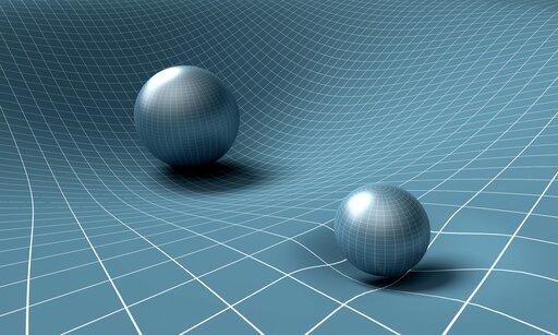 0267 Od czego zależy wartość natężenia pola grawitacyjnego?